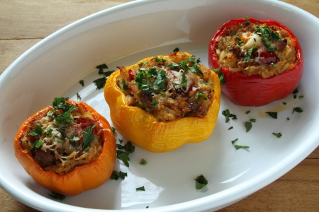 Stuffed paprika with meat, rice and vegetables.  Stock Photo