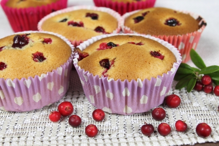 Freshly baked cowberry muffins with cowberries. photo
