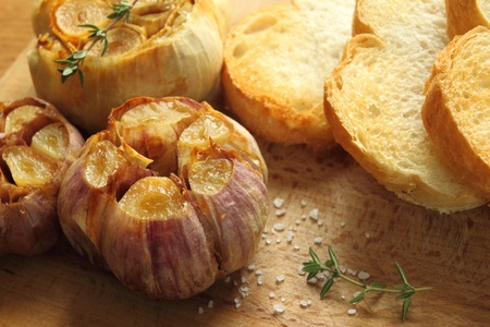 Fresh roasted garlic with olive oil and spices. photo