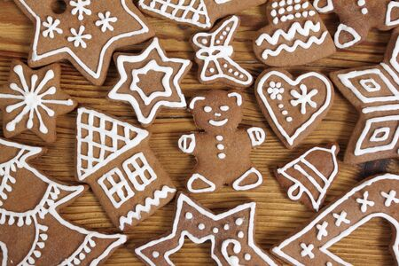Gingerbread cookies on wooden background. Christmas decoration. photo