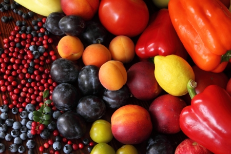 harvest time: Ripe vegetables and fruits. Organic produce. Tomatoes,  plums, pepper, cowberries, apples and other food. Stock Photo