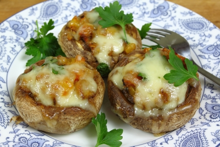 melted cheese: Delicious stuffed mushrooms with meat and cheese.