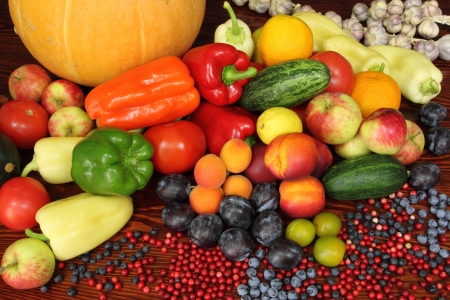 Ripe vegetables and fruits. Organic produce. Tomatoes,  plums, pepper, cowberries, zucchini, apples and other food. photo