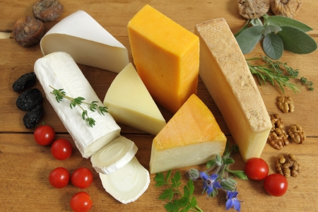 Cheese board - various types of soft and hard cheese. International dairy delicacies. photo