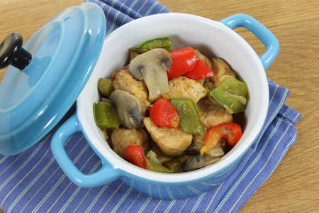 Dish of baked chicken and steamed vegetables photo