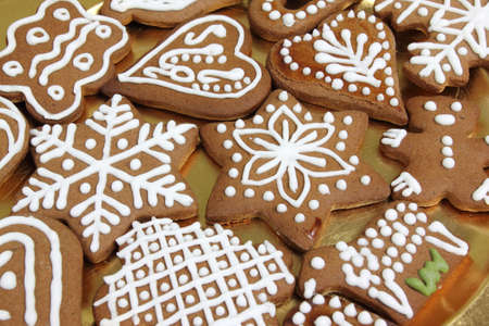 Homemade gingerbread cookies on a golden plate. photo