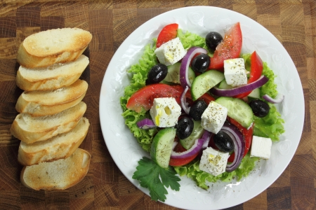 greek salad: Colorful Greek salad on white plate. Healthy eating. Stock Photo