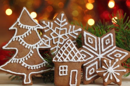 Gingerbread cookies and colored lights. Christmas decoration. photo