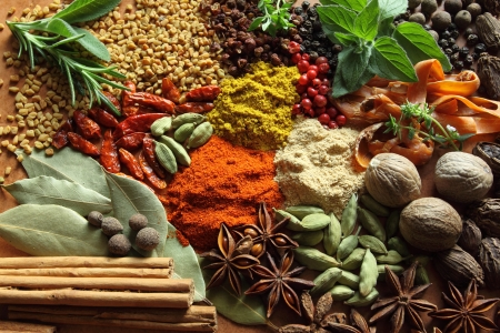 fenugreek: Herbs and spices composition. Cooking ingredients on a ceramic tabletop.