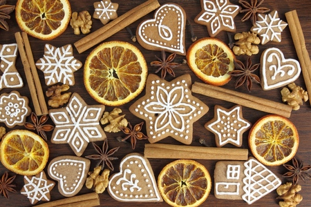 christmas cake: Gingerbread cookies on wooden background. Christmas decoration.