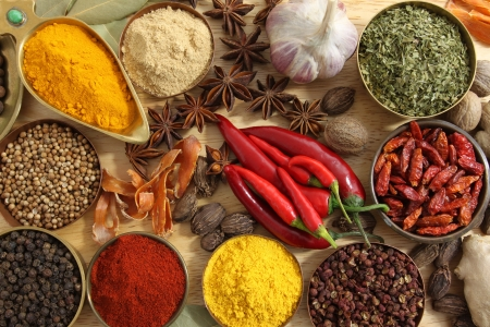 Spices and herbs in metal  bowls. Food and cuisine ingredients. photo