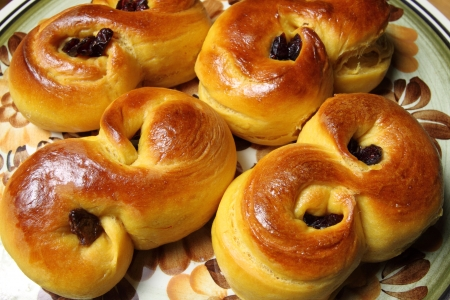 Sweet Swedish buns baked with saffron, cranberries and raisins Stock Photo - 24971922