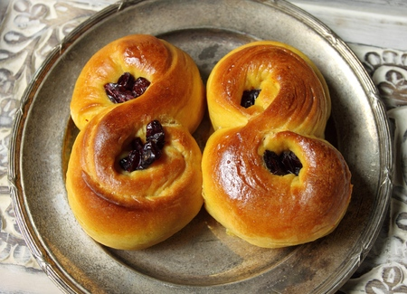 Sweet Swedish buns baked with saffron, cranberries and raisins Stock Photo - 25111309