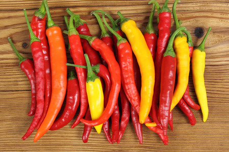 cayenne: Colorful, fresh cayenne peppers on a wooden