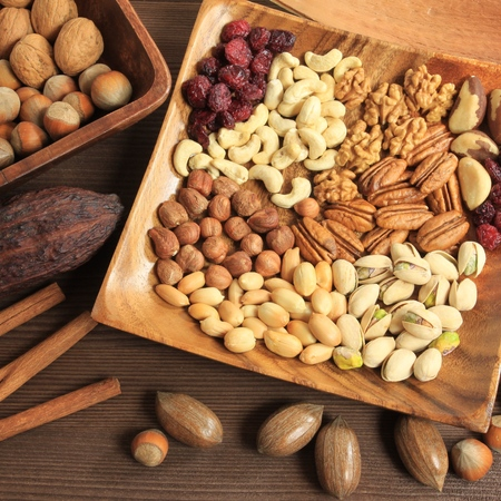 Varieties of nuts: peanuts, hazelnuts, chestnuts, walnuts, cashews, pistachio and pecans. Food and cuisine. Square composition.