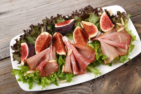 pine nuts: Salad with prosciutto ham, figs and pine nuts.