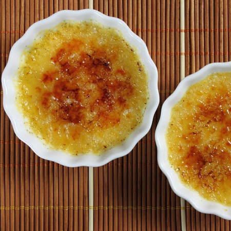 square composition: French dessert - creme brulee. Sweet caramelized custard. Square composition. Stock Photo