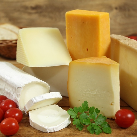 moulded: Cheese board - various types of soft and hard cheese. Square composition. Stock Photo