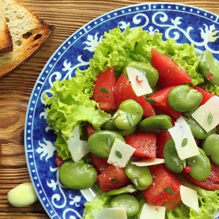 broad: Close up of a broad beans salad with tomato and goat cheese.