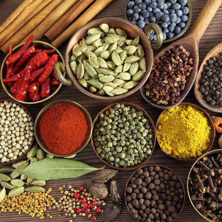 spice: Spices and herbs in metal  bowls and wooden spoons.  Stock Photo