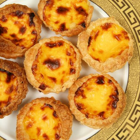 portugese: Portugese pastries - pasteis de nata. Delicious home made cuisine. Typical for Lisbon region. Stock Photo