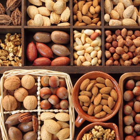 square composition: Varieties of nuts: peanuts, hazelnuts, chestnuts, walnuts,  pistachio and pecans. Food and cuisine. Square composition. Stock Photo