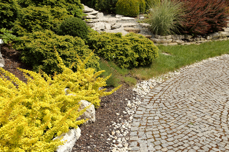 ornamental garden: Path of granite paving in the ornamental garden. Stock Photo
