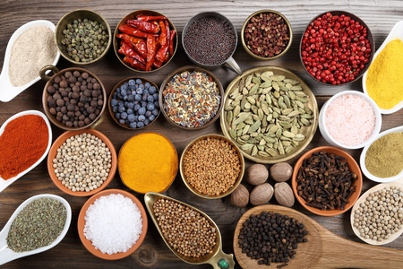 indian mustard: Aromatic spices in metal and ceramic bowls.