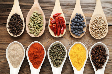 indian spice: Aromatic spices on wooden spoons. Food ingradients. Stock Photo