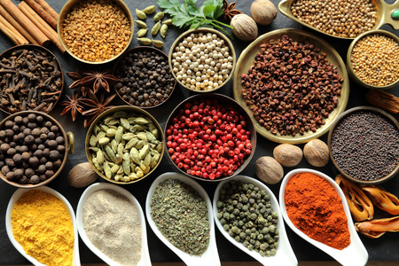 fenugreek: Aromatic spices in metal and ceramic bowls.
