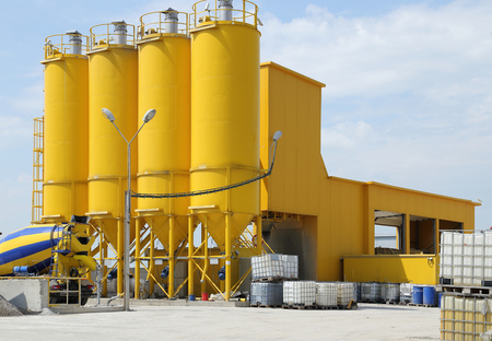 concrete structure: A group of processing silos of a concrete factory . Industrial structure.