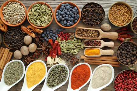 food additives: Aromatic spices in metal and ceramic bowls.