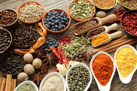 spice: Aromatic spices in metal and ceramic bowls.