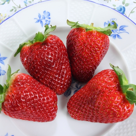 white yummy: Red fresh strawberries on a  plate. Delicious fruit.