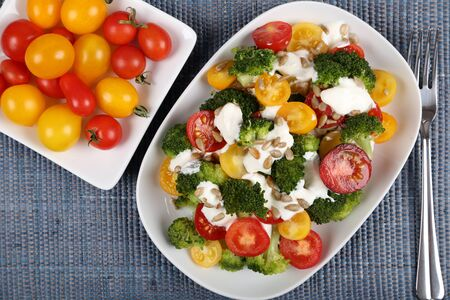 broccoli salad: Fresh salad of colorful tomatoes, broccoli, sunflower seeds and garlic dressing.
