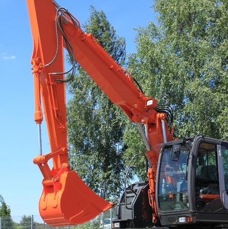 machines: New, shiny and modern orange excavator machines. Construction industry machinery.