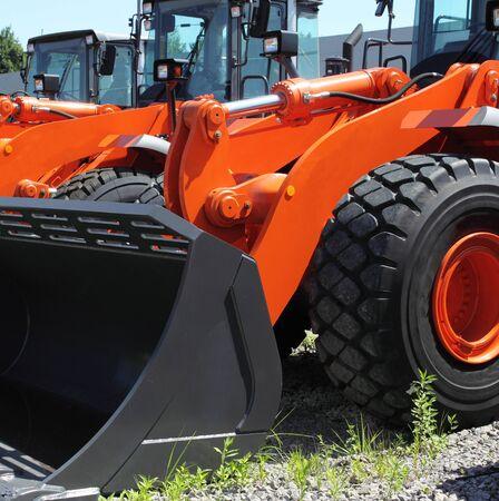 dozer: New, shiny and modern orange dozer machine. Construction industry machinery. Stock Photo