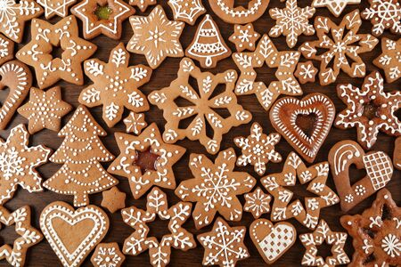 decorated: Christmas homemade gingerbread cookies on wooden table.