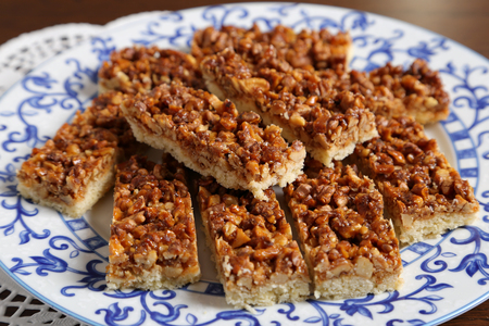 caramelized: A plate of cake with caramelized walnuts. Stock Photo