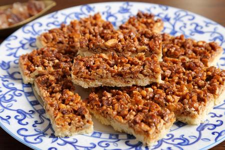 walnut: A plate of cake with caramelized walnuts. Stock Photo