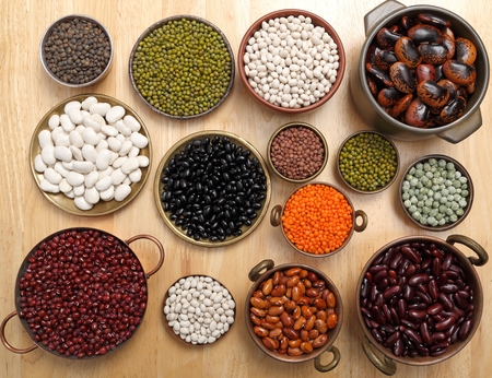 pea: Beans, peas and lentils in metal bowls.