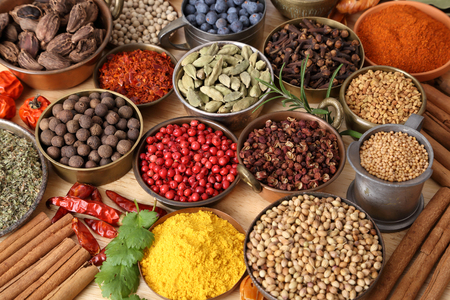Colorful, aromatic spices in bowls on the table.