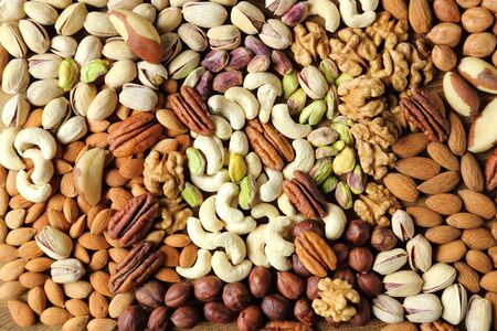 kinds: Natural background made from different kinds of nuts.