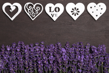 fondos violeta: Frame with lavender and wooden heart on a dark background.