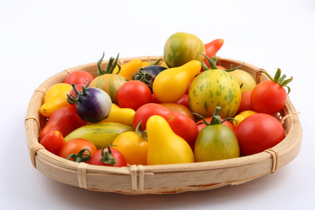 variety: Colorful different kind tomatoes in wooden basket