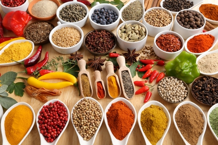 food additives: Herbs and spices in ceramic bowls. Aromatic ingredients and natural food additives.