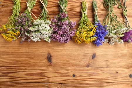 yarrow: Different types of fresh herbs on a wooden background. Stock Photo