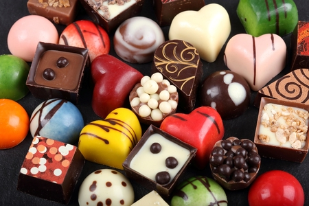 chocolate treats: Assortment of sweet confectionery with chocolate candies and pralines.