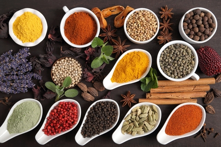 Colorful and aromatic herbs and spices on a dark wooden background. Stock fotó
