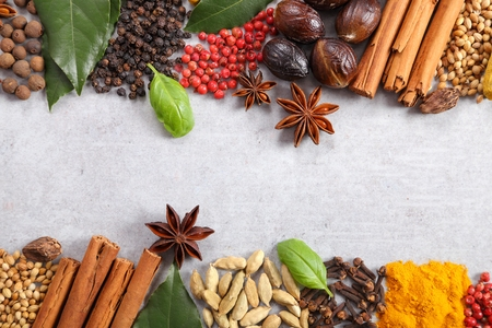 Aromatic Indian spices on a gray ceramic background. Stock Photo